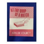 At the Drop of a Match by Ken De Courcy